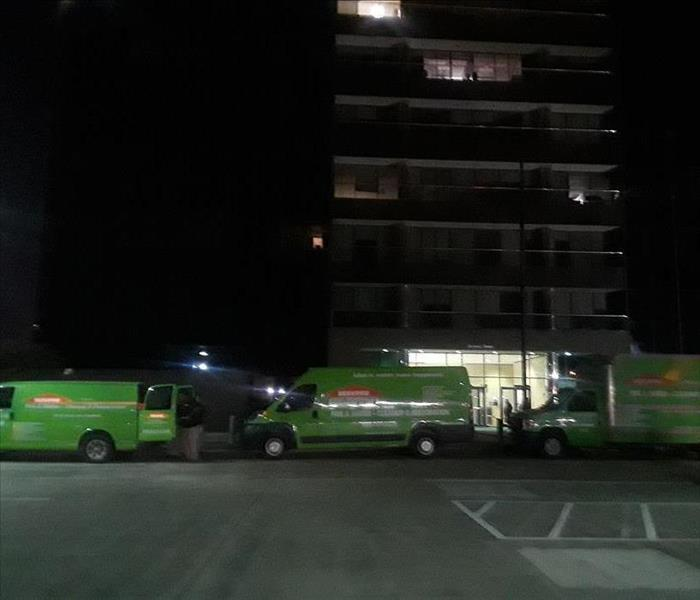 Our Green Trucks Parked on the Commercial Loss Scene